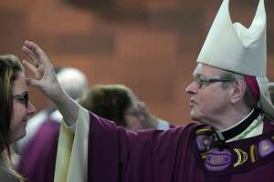 Bishop Edward Schargenberger marks a woman's forehead with ashes during an Ash Wednesday service at the Cathedral of Immaculate Conception on Wednesday, March 1, 2017, in Albany, N.Y.   (Paul Buckowski / Times Union)