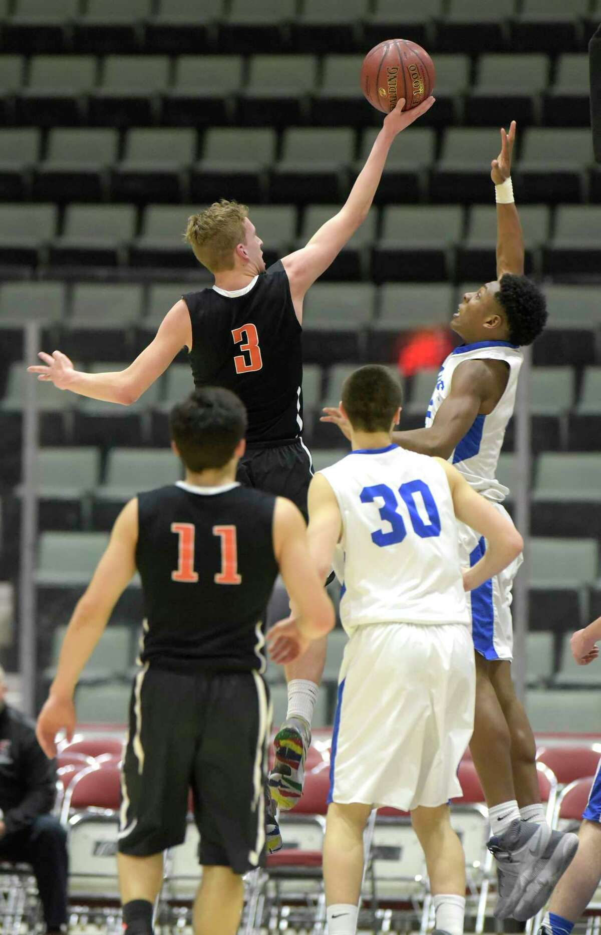 Hayden Thompson of Bethlehem puts up a shot over Jelani Wiggins of La Salle Institute during their Class AA semifinal game at the Glens Falls Civic Center on Tuesday, Feb. 28, 2017, in Glens Falls, N.Y. (Paul Buckowski / Times Union)