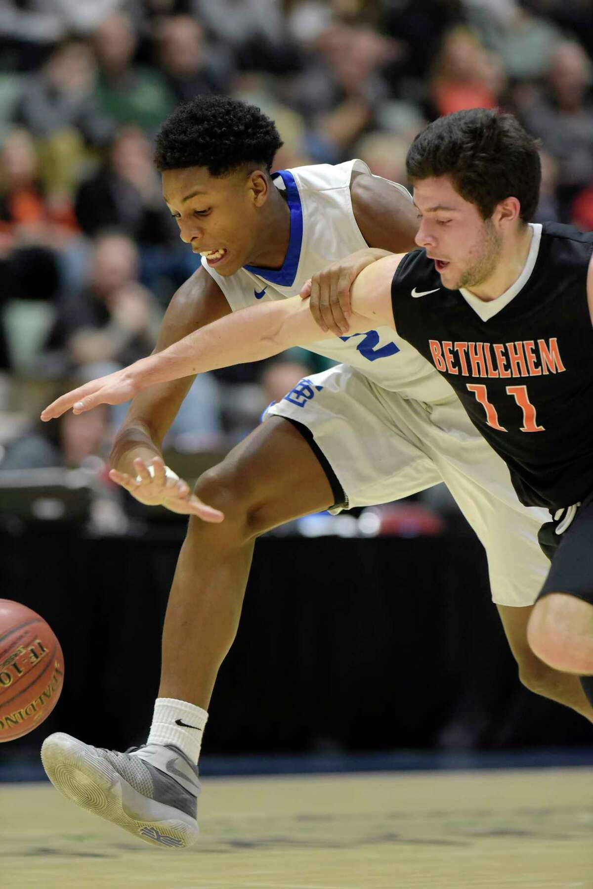 Jelani Wiggins of La Salle Institute, left, and Matthew Riker of Bethlehem battle for a loose ball during their Class AA semifinal game at the Glens Falls Civic Center on Tuesday, Feb. 28, 2017, in Glens Falls, N.Y. (Paul Buckowski / Times Union)