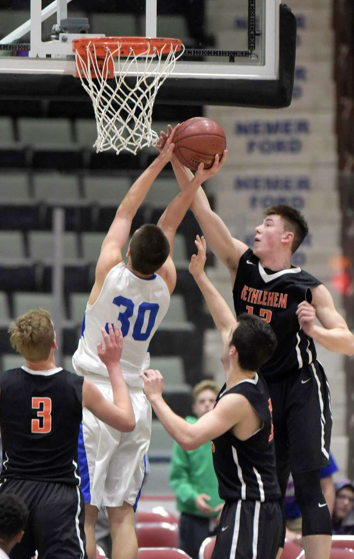 Tim Carroll of La Salle Institute puts up a shot as Micheal Ortale of Bethlehem tries to block it during their Class AA semifinal game at the Glens Falls Civic Center on Tuesday, Feb. 28, 2017, in Glens Falls, N.Y. (Paul Buckowski / Times Union)