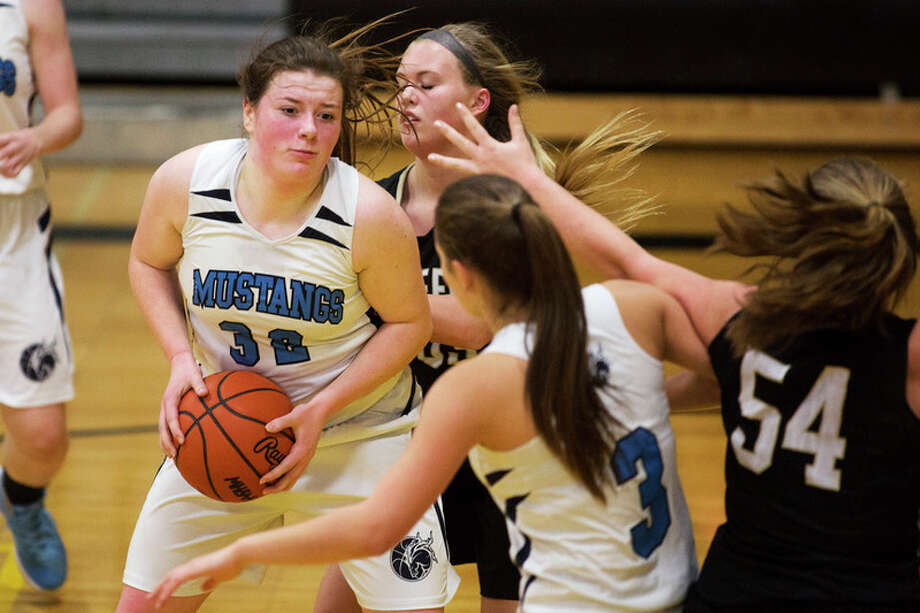 THEOPHIL SYSLO | For the Daily News Meridian's Audrey Kielpinski controls the ball while being defended by Bullock Creek's Mayson Barringer in Wednesday's game.