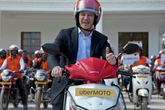 """Travis Kalanick, shown during Uber's launch of its bike-sharing product in Hderabad, India, says: """"I must fundamentally change as a leader and grow up."""""""