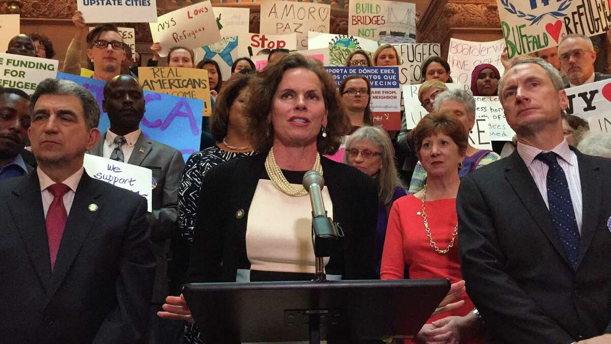Assemblywoman Patricia Fahy, D-Albany, discusses a proposal to include $12 million in the state budget to assist with refugee resettlement efforts during a press conference at the state Capitol in Albany, N.Y., Wednesday, March 1, 2017.