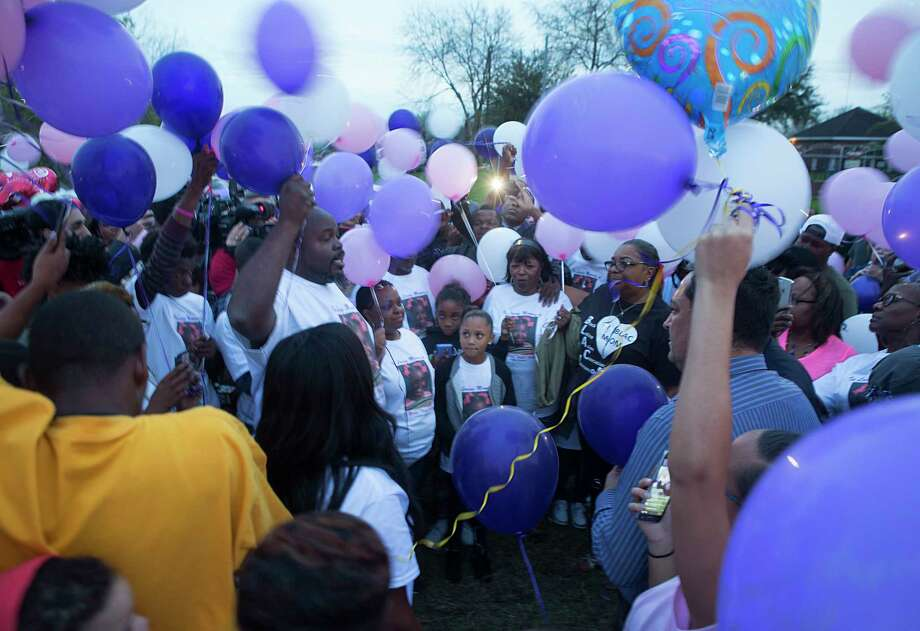 "De'Maree Adkins' father, Detram Adkins, and mother, Latoyia Thomas, address the crowd assembled for a balloon release in memory of their 8-year-old daughter, who loved to write and was called a ""girly-girl."" Photo: Mark Mulligan, Staff / © 2017 Houston Chronicle"