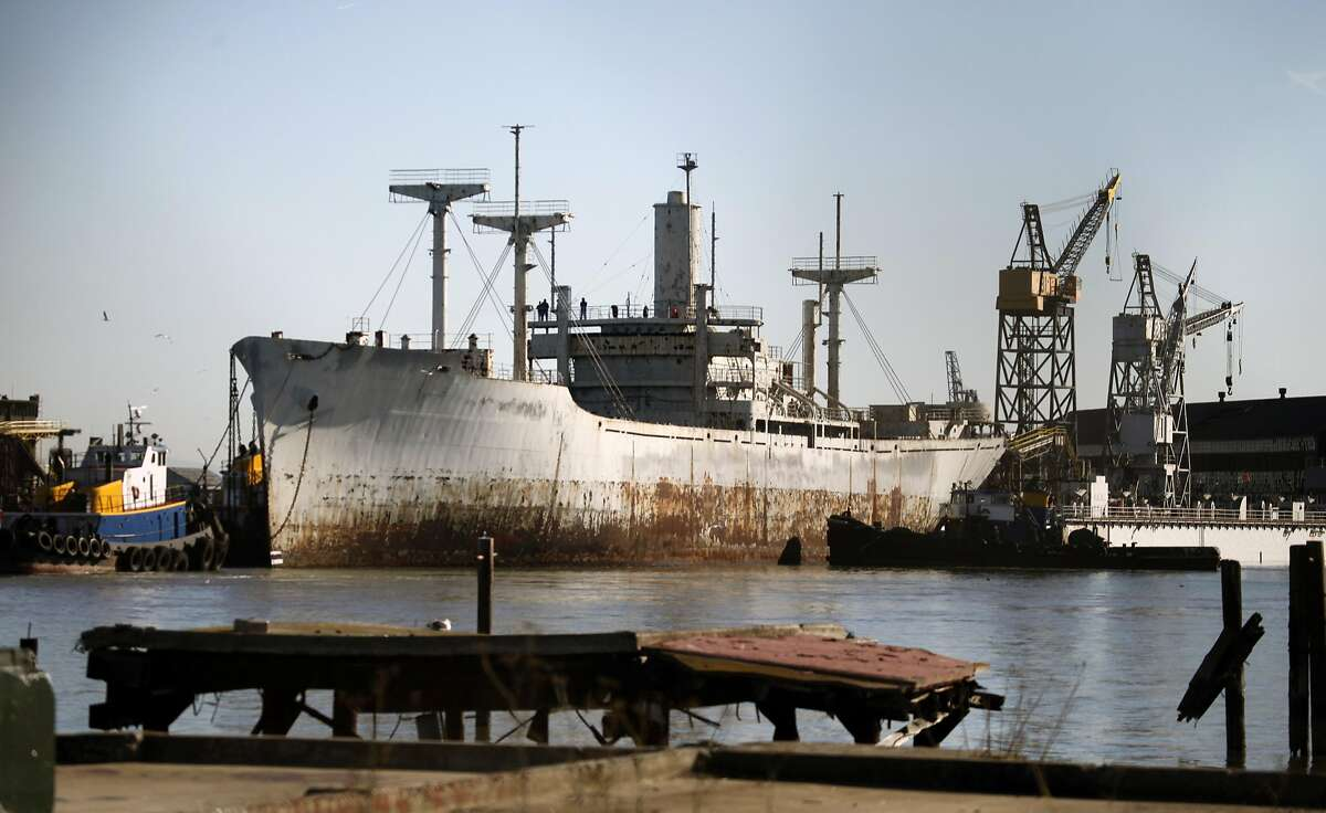 Tugboats maneuver the Pan American Victory into dry dock at San Francisco's pier 70 Tuesday November 24, 2009. Pan American Victory is the first mothball fleet ship ordered by the Federal Government to be cleaned up and scrapped.
