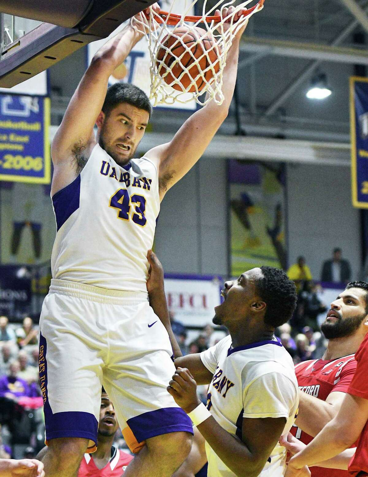 UAlbany's #43 Greig Stire, left, gets congratulated on his dunk by team mate #12 Devonte Campbell during their first round game of the America East Conference Tournament against Hartford Wednesday March 1, 2017 in Albany, NY. (John Carl D'Annibale / Times Union)