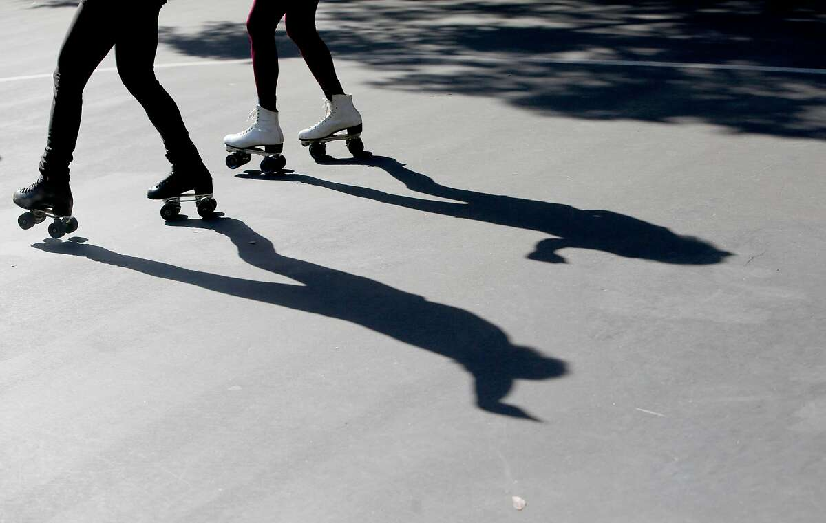 """People dance while roller skating to music playing at """"Skatin' Park"""" in Golden Gate Park near 6th and Fulton St. on Sunday, Feb. 26, 2017, in San Francisco, Calif."""