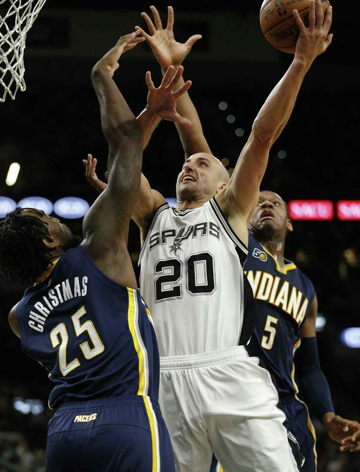 Manu Ginobili splits two Indiana Pacers defenders on March 1, 2017.