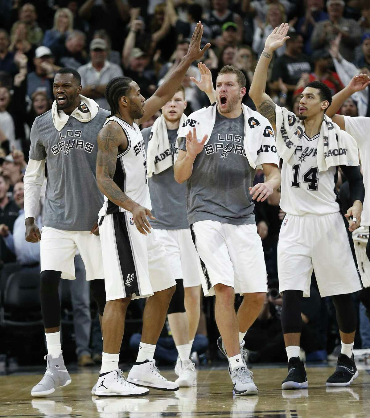 Spurs?' Kawhi Leonard (02) gets congratulated by the team bench after hitting the winning shot against the Indiana Pacers at the AT&T Center on Wednesday, Mar. 1, 2017. Spurs defeated the Pacers, 100-99. (Kin Man Hui/San Antonio Express-News)