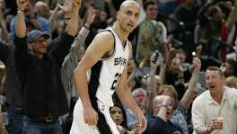 Manu Ginobili walks off after hitting a crucial 3-pointer onMarch 1 as the Spurs beat Indiana.