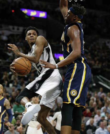 Spurs' Dejounte Murray (05) looks to pass against Indiana Pacers' Myles Turner (33) during their game at the AT&T Center on Wednesday, Mar. 1, 2017. Spurs defeated the Pacers, 100-99. (Kin Man Hui/San Antonio Express-News) Photo: Kin Man Hui, Staff / San Antonio Express-News / ©2017 San Antonio Express-News