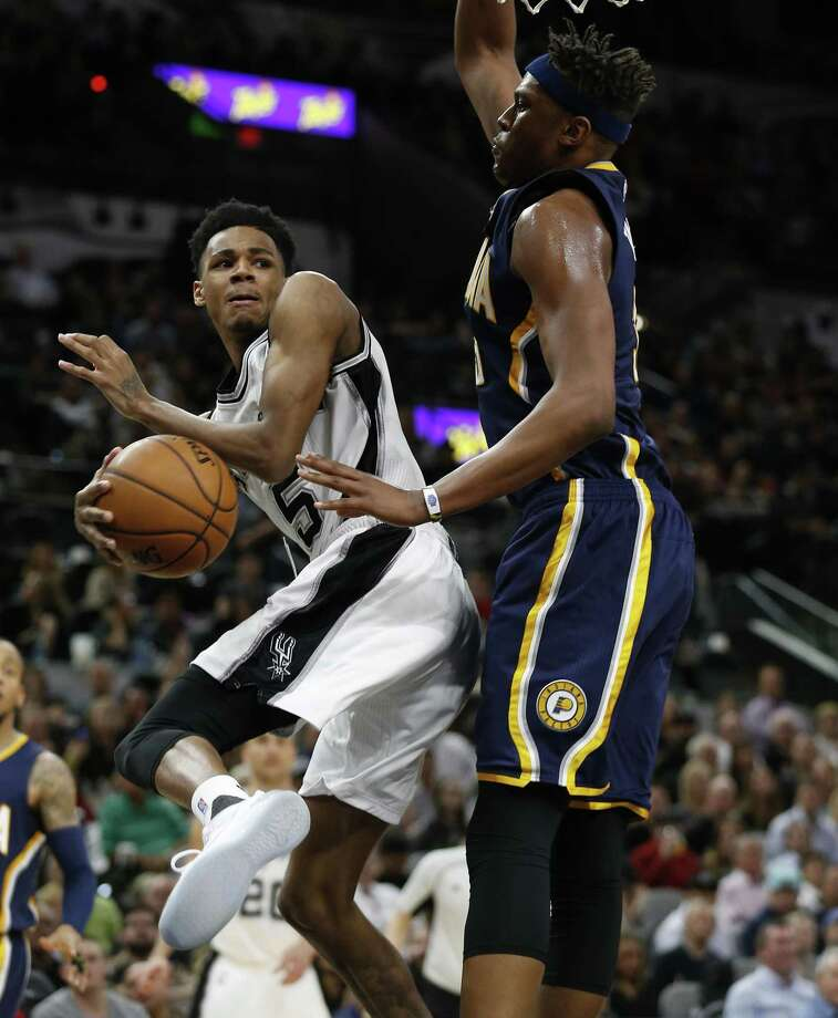 Spurs' Dejounte Murray looks to pass around the Indiana Pacers' Myles Turner at the AT&T Center on March 1, 2017. Photo: Kin Man Hui /San Antonio Express-News / ©2017 San Antonio Express-News