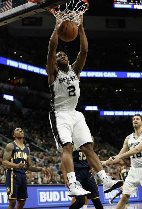 Spurs' Kawhi Leonard (02) dunks against the Indiana Pacers during their game at the AT&T Center on Wednesday, Mar. 1, 2017. (Kin Man Hui/San Antonio Express-News) Photo: Kin Man Hui, Staff / San Antonio Express-News / ©2017 San Antonio Express-News