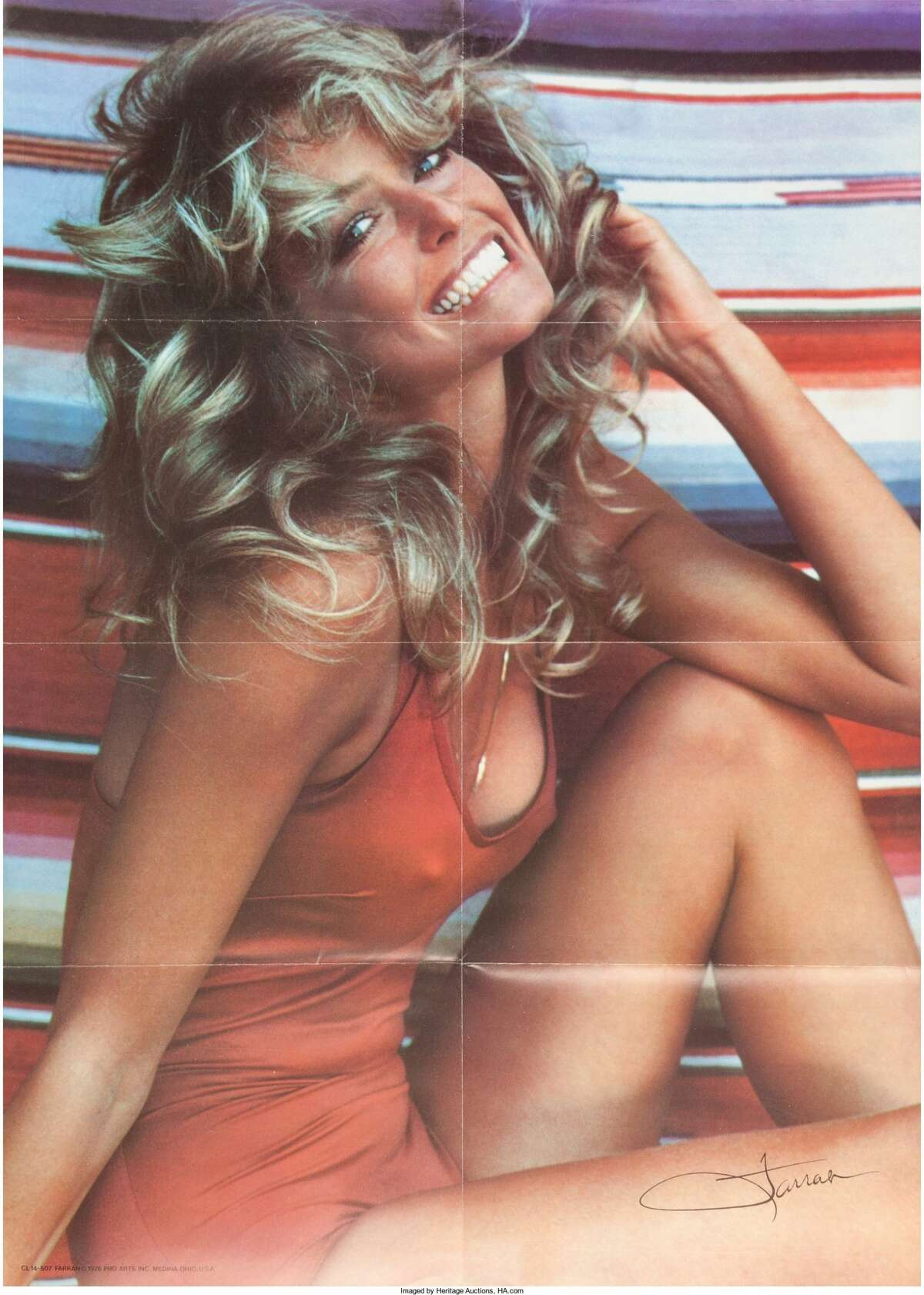 A Farrah Fawcett Personally-Owned Group of THE Posters, Circa 1970s. Quite possibly one of the most famous posters (and easily one of the biggest selling ones) of the 20th century; 36 total, depicting the star in her now infamous red one-piece bathing suit as she sits against a striped background, her facsimile signature of