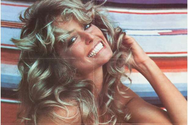 """A Farrah Fawcett Personally-Owned Group of THE Posters, Circa 1970s. Quite possibly one of the most famous posters (and easily one of the biggest selling ones) of the 20th century; 36 total, depicting the star in her now infamous red one-piece bathing suit as she sits against a striped background, her facsimile signature of """"Farrah"""" is printed in the lower right corner, text reading """"CL 14-507 Farrah 1976 Pro Arts Inc., Medina, Ohio, U.S.A."""" is printed in the lower left corner; folded; hard to know if these particular ones were from the original 1976 print run or were made later, but we DO know that they were owned by the poster girl herself! Starting Bid: $1000"""