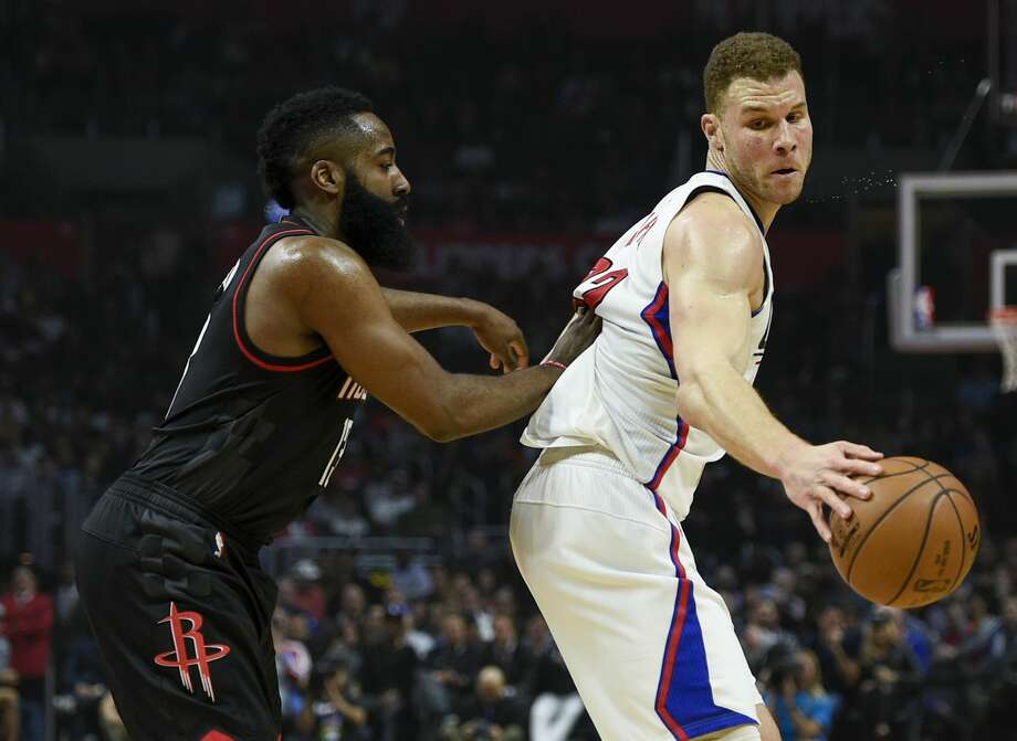 Los Angeles Clippers forward Blake Griffin, right, posts up on Houston Rockets guard James Harden during the first half of an NBA basketball game in Los Angeles, Wednesday, March 1, 2017. (AP Photo/Kelvin Kuo) Photo: Kelvin Kuo/Associated Press