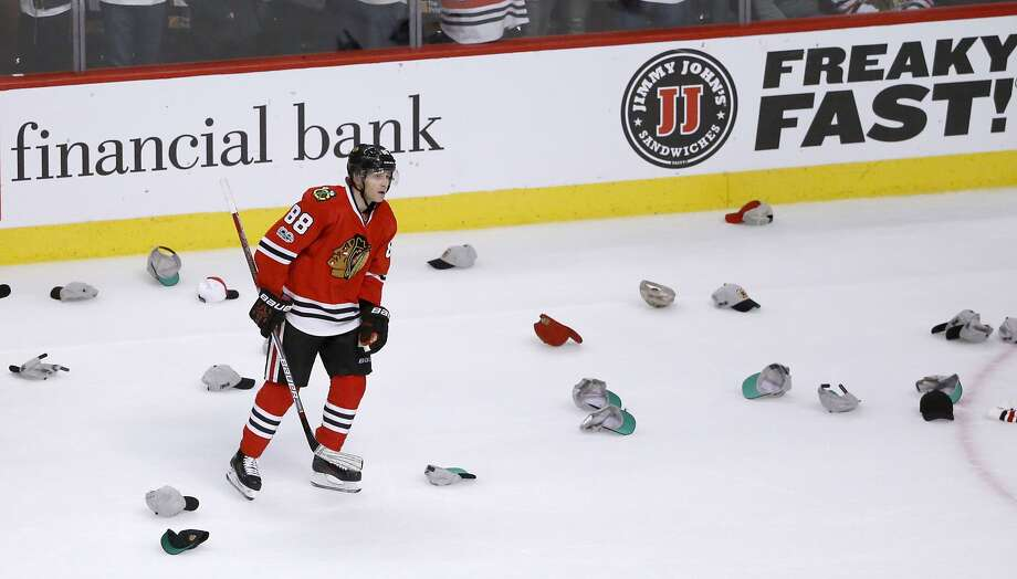 Chicago Blackhawks' Patrick Kane skates among several hats after scoring a hat trick against the Pittsburgh Penguins, during the third period of a 4-1 home win. Photo: Charles Rex Arbogast, Associated Press