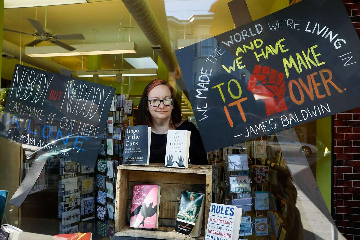 Christin Evans, owner of Booksmith bookstore, in the front window display as seen in San Francisco, California on Wednesday March 1, 2017.