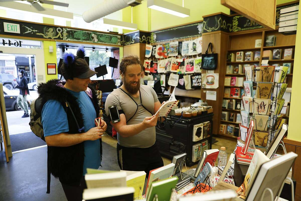 Koyote (right) and Meow Meow (left) browsing books at Booksmith bookstore as seen in San Francisco, California on Wednesday March 1, 2017.