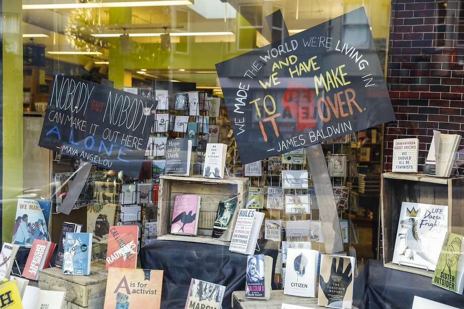 The window display at Booksmith in the Haight reflects the store's and the community's spirit of high-energy activism. Photo: Craig Lee, Special To The Chronicle