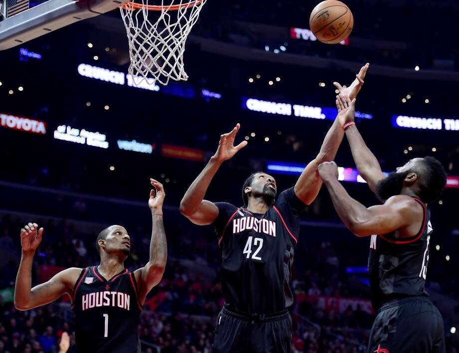 LOS ANGELES, CA - MARCH 01:  James Harden #13, Nene Hilario #42 and Trevor Ariza #1 of the Houston Rockets control a rebound during a 122-103 win over the LA Clippers at Staples Center on March 1, 2017 in Los Angeles, California.  NOTE TO USER: User expressly acknowledges and agrees that, by downloading and or using this photograph, User is consenting to the terms and conditions of the Getty Images License Agreement.  (Photo by Harry How/Getty Images) Photo: Harry How/Getty Images