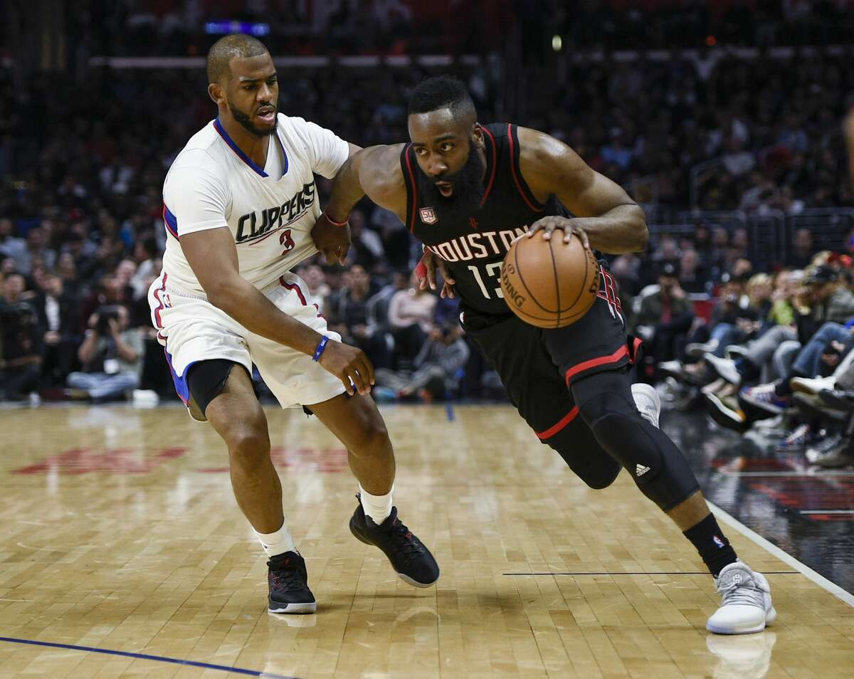 Houston Rockets guard James Harden, right, drives as Los Angeles Clippers guard Chris Paul defends during the second half of an NBA basketball game in Los Angeles, Wednesday, March 1, 2017. The Rockets won 122-103. (AP Photo/Kelvin Kuo)