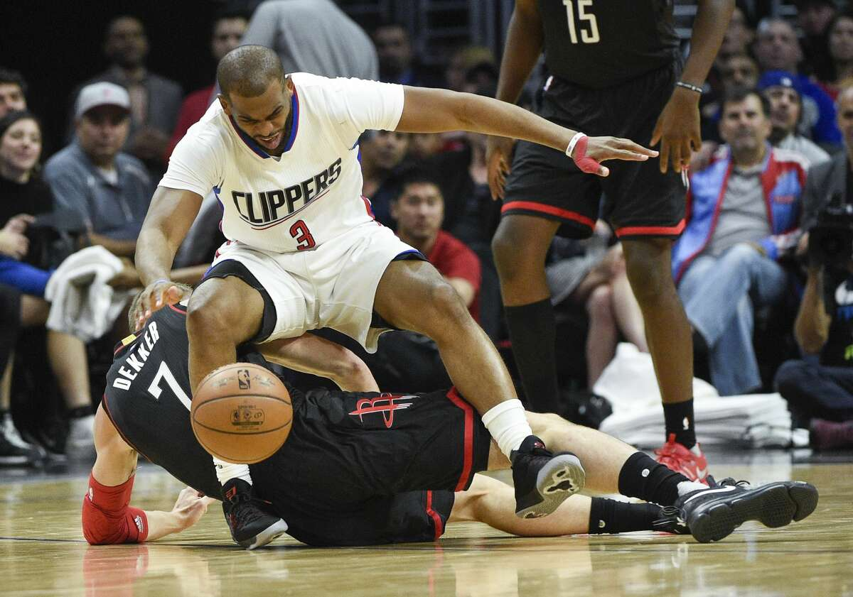 Los Angeles Clippers guard Chris Paul, top, loses the ball after running into Houston Rockets forward Sam Dekker during the second half of an NBA basketball game in Los Angeles, Wednesday, March 1, 2017. The Rockets won 122-103. (AP Photo/Kelvin Kuo)