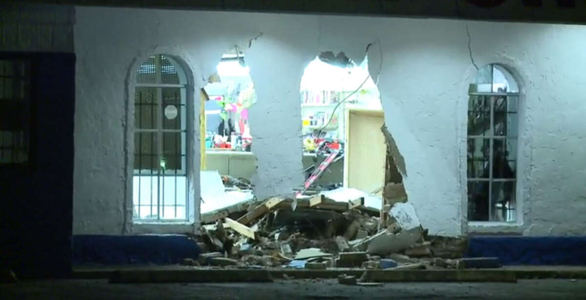 Burglars got away with stolen guns early Thursday after they rammed a truck into a pawn shop near Houston's East End, police said.
