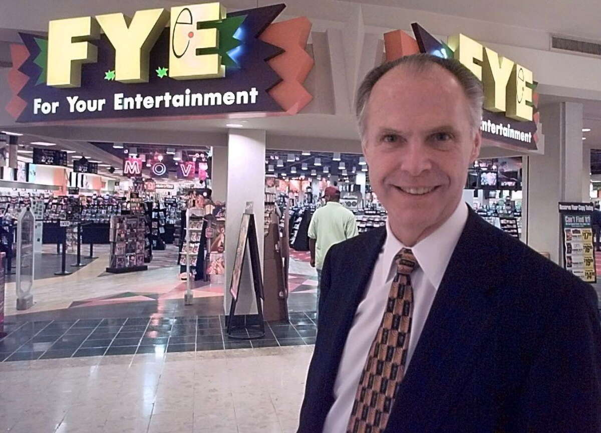 Robert Higgins, president of Trans World Entertainment, stands in front of the Colonie Center store in 1998.