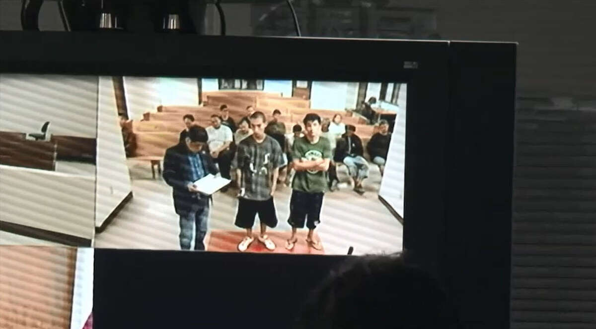 Miguel Alvarez-Flores, 22, (in green), and Diego Hernandez-Rivera appear in court early Thursday, March 2, 2017 to hear charges read against them in the kidnapping, physical and sexual torture and murder of an unidentified teen girl.