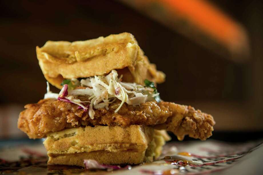 Chicken & Waffle Sandwich made with crispy fried chicken breast,  cider slaw, maple butter, and Crystal Hot sauce on a Belgium waffle at  Krisp Bird & Batter. Photo: Brett Coomer, Houston Chronicle / © 2017 Houston Chronicle