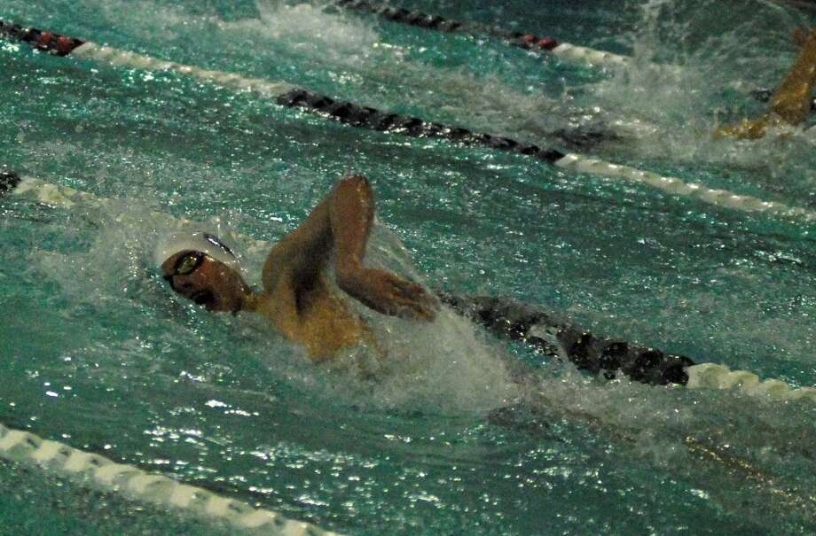 Staples' Nico Ortega swims in winning the 400 freestyle in a meet against New Canaan on Wednesday. Photo: Ryan Lacey / Hearst Connecticut Media