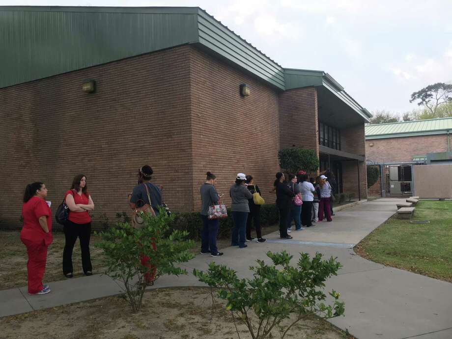 Beaumont ISD parents lined up outside the Administration Building Wednesday morning to submit applications for their students to transfer schools within the district. Photo: Liz Teitz
