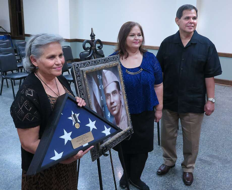 Family members, from left, Virginia Coe, Cynthia Aguilar and Dennis Tijerina accepted the Prisoner of War Medal on behalf of their father. Alvaro F. Tijerina, at a special ceremony to be held at the American Legion Post 59, Wednesday. Photo: Cuate Santos /Laredo Morning Times / Laredo Morning Times