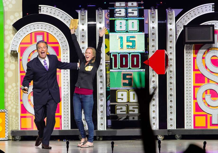 "Live-show host Todd Newton congratulates a contestant in the touring version of the TV game show ""The Price Is Right."" Photo: Courtesy Image"