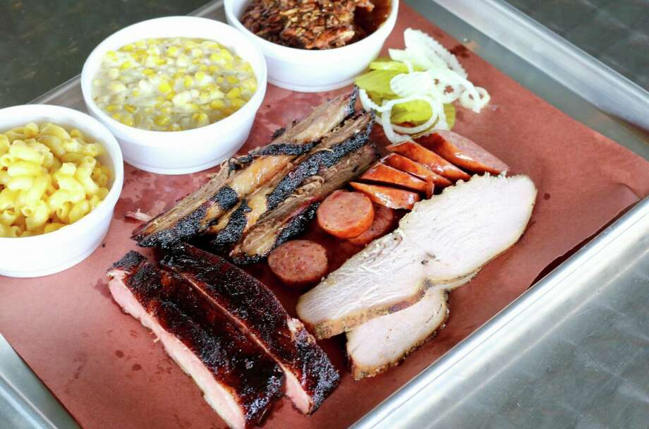 Country singer Wade Bowen and entrepreneur Douglas McReaken are making waves in old town Alvin with their new barbecue joint, The Caboose BBQ. Photo: The Caboose BBQ/Facebook