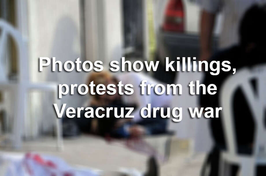 WARNING: This slideshow includes graphic images. Scroll through the slideshow to see the death and destruction that has plagued the Mexican port city of Veracruz due to the drug war, as well as how the community is reacting to the violence. Photo: AFP/AFP/Getty Images