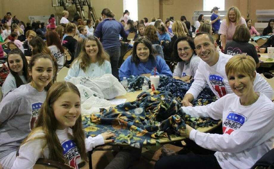Mothers and daughters from the National Charity League, Inc., Lady Bird Chapter met with nine other chapters in their district for Ticktocker Day on Feb. 4. From left are Mary Shank from the NCL Cypress Gems Chapter, Daniela Zamora from the NCL Lady Bird Chapter, Allison Gill from the NCL Lady Bird Chapter, Carrie Shank from the NCL Cypress Gems Chapter, Patricia Kramer from the NCL Lady Bird Chapter, Carrie Zamora from the NCL Lady Bird Chapter, Carrie Morey Zamora from the NCL Lady Bird Chapter, Richard Sandefer from Camp Hope and Janette Gill from the NCL Lady Bird Chapter. Photo: Lady Bird Chapter / Lady Bird Chapter