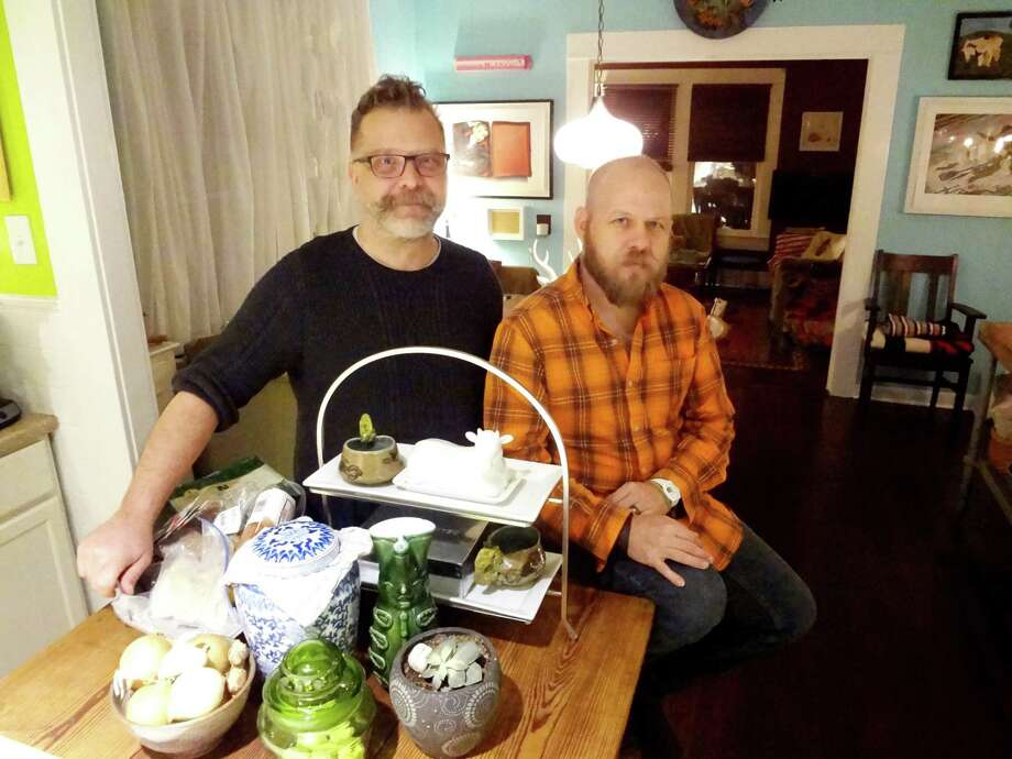 """Rick Frederick and Chris Sauter, shown in their dining room, have lived in their East Side home for a decade. When they bought the house, it had been """"overflipped — all those generic cabinets,"""" Frederick said. Photo: Steve Bennett / San Antonio Express-News"""