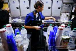 United Airlines flight attendant trainee Lauren Franco prepares the beverage carts on a flight from Chicago to Houston as she works her second training flight as part of her final test to graduate flight attendant school and get her wings Monday, Nov. 7, 2016. ( Michael Ciaglo / Houston Chronicle )