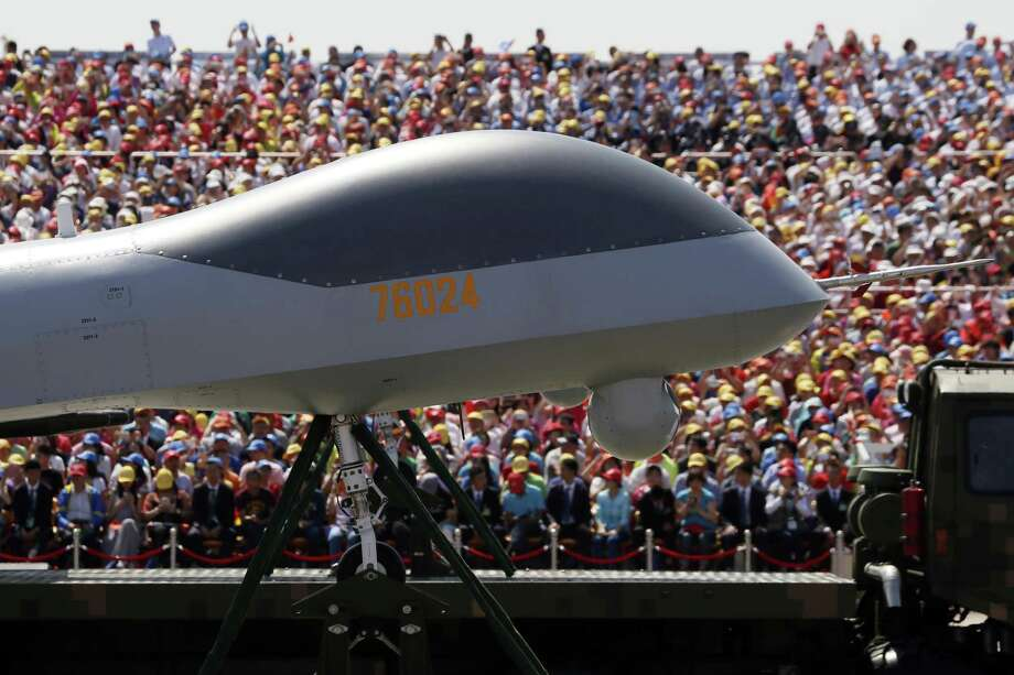 FILE - In this file photo taken Thursday, Sept. 3, 2015, the front of the Wing Loong, a Chinese made medium-altitude long-endurance unmanned aerial vehicle, moves past spectators during a parade commemorating the 70th anniversary of Japan's surrender during World War II held in Beijing. Double digit annual percentage increases in China's defense budget have been fueling a top-to-bottom modernization drive that has brought in new equipment and vast improvements in living conditions for the People's Liberation Army's 2.3 million members.  (AP Photo/Ng Han Guan, File) Photo: Ng Han Guan, STF / AP / AP