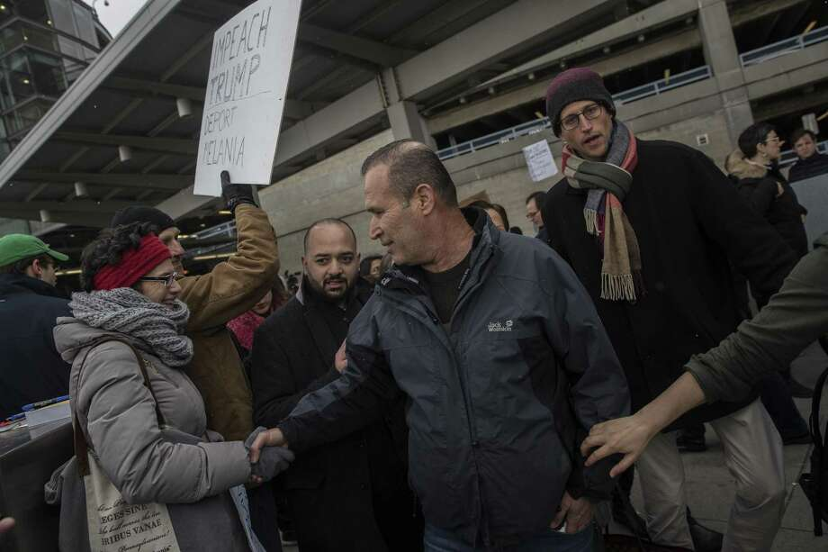 FILE -- Hameed Khalid Darweesh, center, a former interpreter for the US military in Iraq, greets a supporter after his release from detention outside of John F. Kennedy International Airport, in New York, Jan. 28, 2017. A government list shows 746 travelers were detained in a 26-hour period immediately after a federal judge temporarily blocked part of TrumpÕs Jan. 27 order, according to a list released by the government. (Victor J. Blue/The New York Times) Photo: VICTOR J. BLUE, STR / NYT / NYTNS