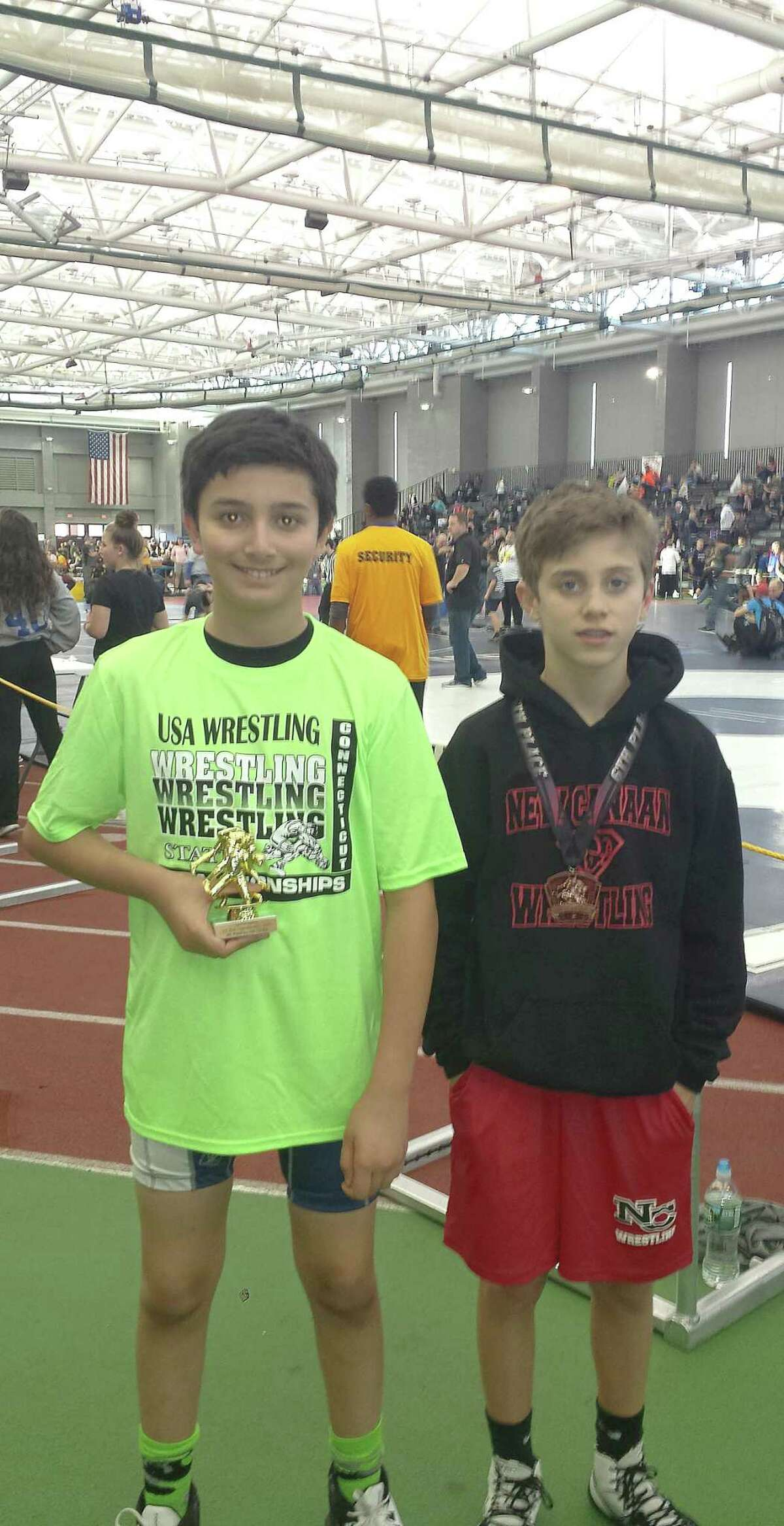 Wilton Youth wrestler Kieran McGuire, left, sporting his 4th place trophy and Max Mannino, a former Wilton Youth Wrestling grappler who now competes in New Canaan, shows off his sixth place medal at the Connecticut State Youth Wrestling Championship meet.