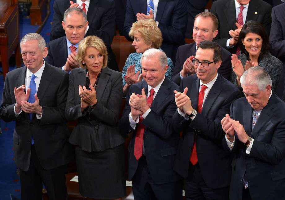 "(FILES) This February 28, 2017 file photo shows Attorney General Jeff Sessions (C) with cabinet members (from left) Defense Secretary James Mattis, Education Secretary Bettsey Devos, Sessions, Treasury Secretary Steven Mnuchin, and Secretary of State Rex Tillerson, applauding US President Donald Trump during his address to a joint session of Congress at the US Capitol in Washington, DC. US Attorney General Jeff Sessions said March 2, 2017 he will recuse himself ""whenever it's appropriate"" from Justice Department probes into alleged ties between Donald Trump's campaign and the Russian government, after coming under fire himself for contacts with Moscow. Sessions met twice with Russia's ambassador to Washington last year, the White House confirmed, while he was serving as both a senator and a top foreign policy adviser to Trump's campaign. / AFP PHOTO / MANDEL NGANMANDEL NGAN/AFP/Getty Images Photo: MANDEL NGAN, AFP/Getty Images"