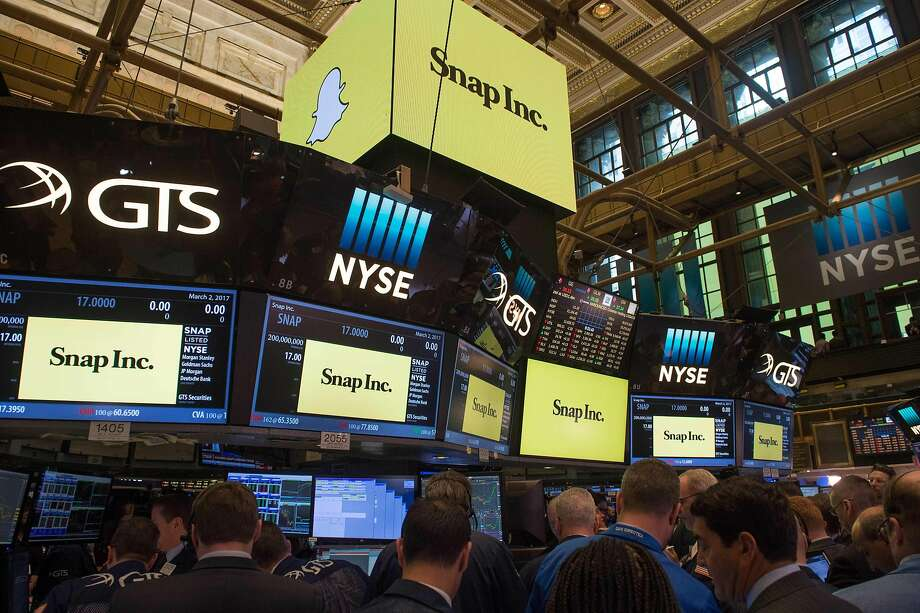 Traders work on the floor during the Snap Inc. IPO at the New York Stock Exchange, March 2, 2017, in New York. Snapchat surged in its debut trade Thursday, jumping more than 40 percent from the level set in the initial public offering Wednesday night. / AFP PHOTO / Bryan R. SmithBRYAN R. SMITH/AFP/Getty Images Photo: BRYAN R. SMITH, AFP/Getty Images