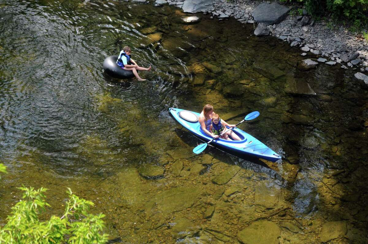 People float along the Battenkill by the Shushan Covered Bridge Museum on Saturday, Aug. 15, 2015, in Shushan, N.Y. (Cindy Schultz / Times Union)