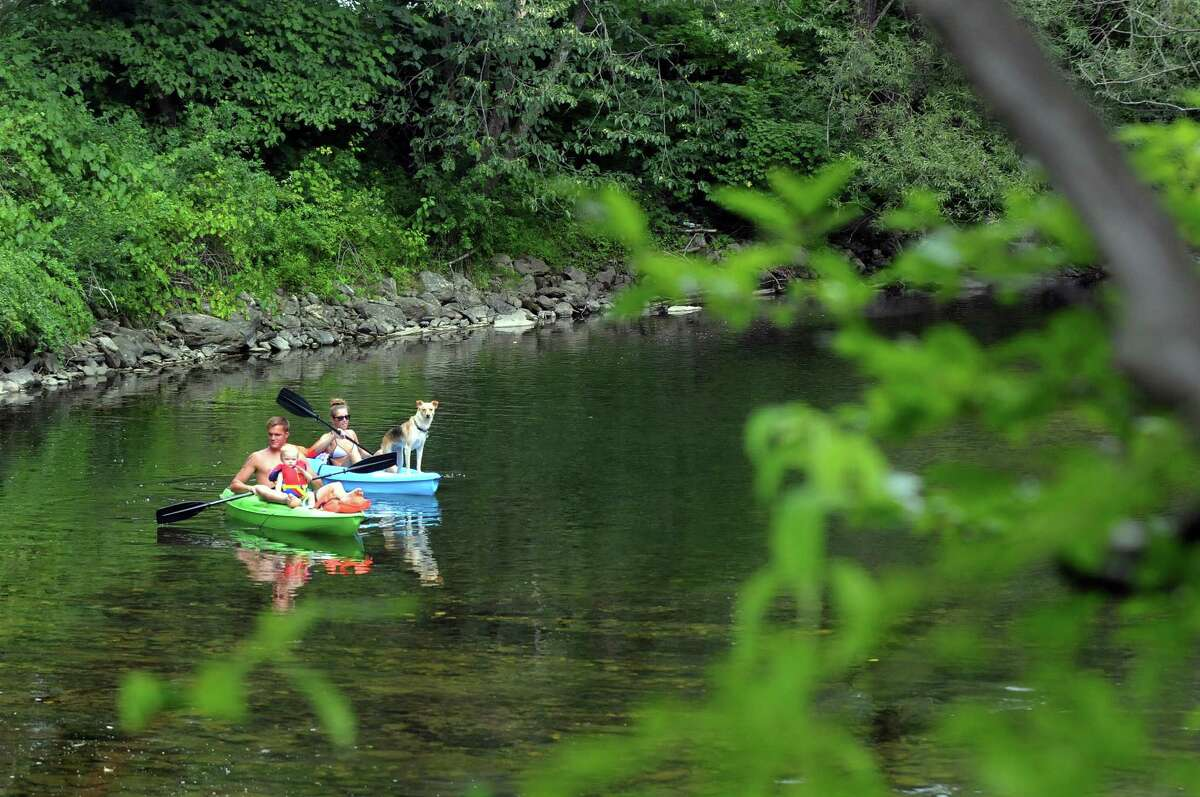 A young family rounds an oxbow on the Battenkill at the Georgi on the Battenkill Community Park and Museum on Saturday, Aug. 15, 2015, in Shushan, N.Y. (Cindy Schultz / Times Union)