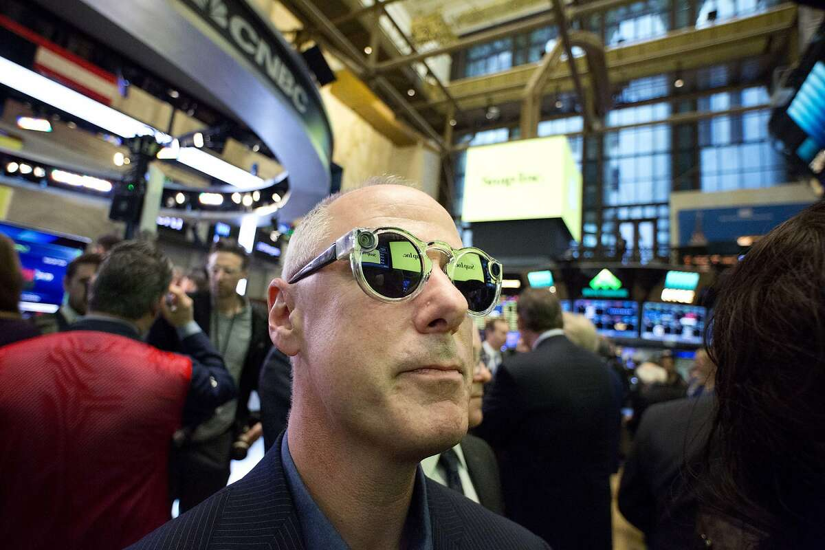 Steve Horowitz, Snap's Vice President of Engineering, wears Snap's Spectacles during the company's IPO at the New York Stock Exchange, Thursday, March 2, 2017. (AP Photo/Mark Lennihan)