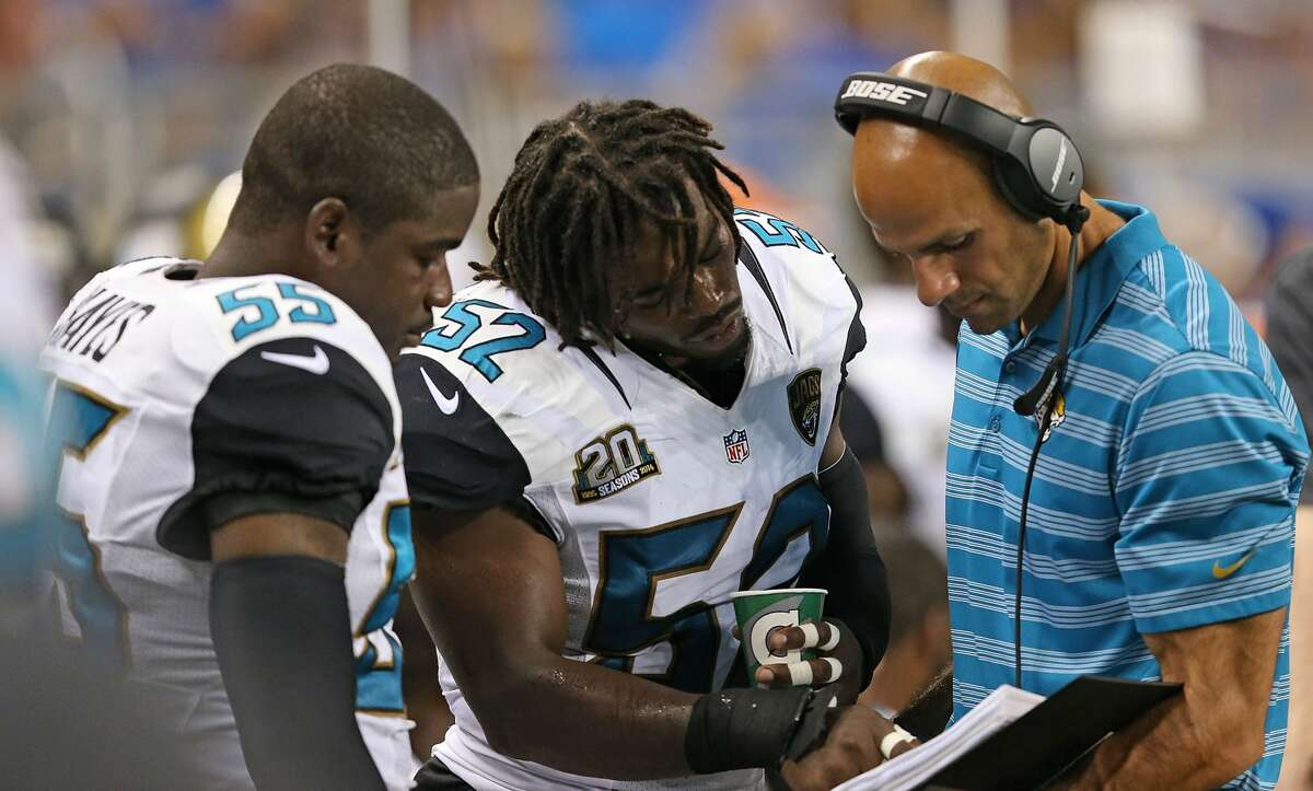 DETROIT, MI - AUGUST 22: Geno Hayes #55 and J.T. Thomas #52 of the Jacksonville Jaguars talk with the linebacker coach Robert Saleh during the preseason game against the Detroit Lions at Ford Field on August 22, 2014 in Detroit, Michigan. The Lions defeated the Jaguars 13-12. (Photo by Leon Halip/Getty Images)