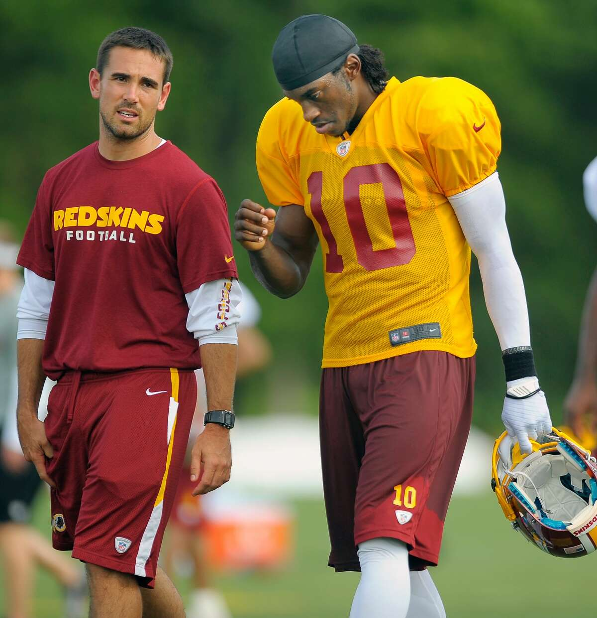 ASHBURN VA JULY 28: Washington Redskins' quarterbacks coach Matt LaFleur, left, walks off the field with rookie quarterback Robert Griffin III after the 3rd day of training camp at Redskins Park in Ashburn VA July 28 2012 (Photo by John McDonnell/The Washington Post via Getty Images)